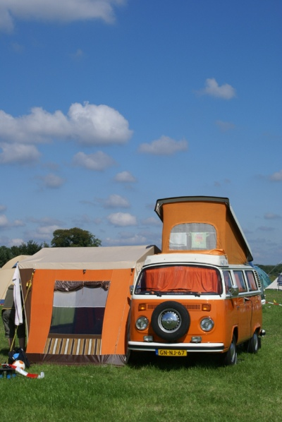 A latebay Kombi with a side tent.