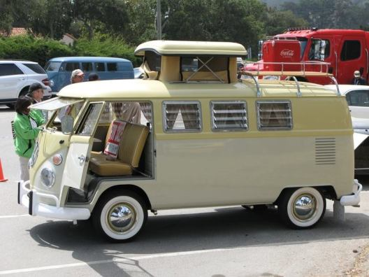 A split-bus with an early type of pop-top roof.