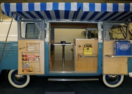 A rare double-side door split bus camper.
