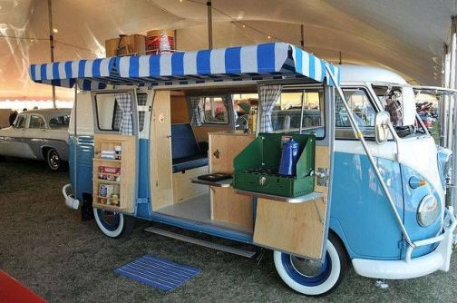 Another split bus camper van with a classic side awning.
