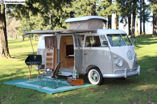 A split bus camper with the early pop-top roof.