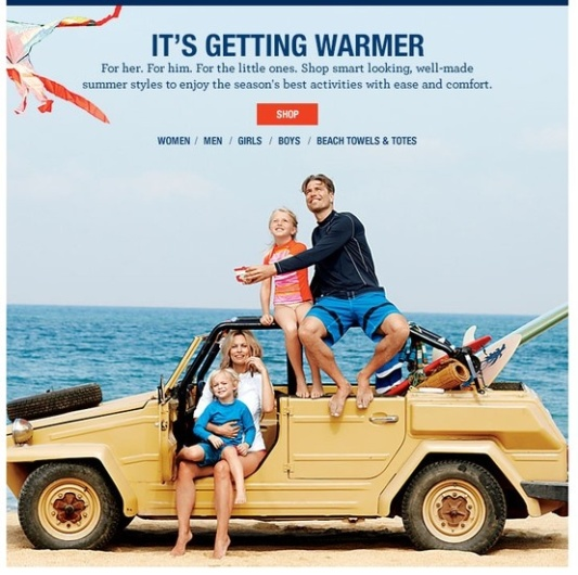 An on-line shopping advertising: a family with a VW Safari on a beach...