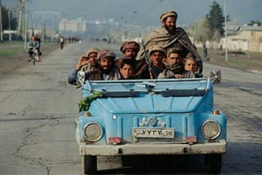 A group of Afghanistan tribe riding a VW Safari...